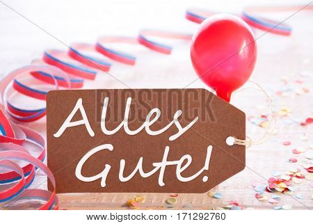 One Label With German Text Alles Gute Means Best Wishes. Party Decoration Like Streamer, Confetti And Balloon. Wooden Background With Vintage, Retro Or Rustic Syle