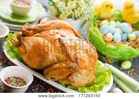 Easter dinner food idea - roasted Easter chicken on festive Easter table