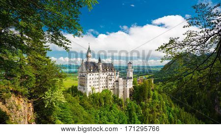Neuschwanstein, Landscape Panorama Of The Fairy Tale Castle In Germany