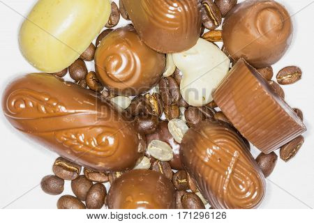 Close Up Of Chocolate Pieces Mixed With Coffee Beans Isolated On White Background