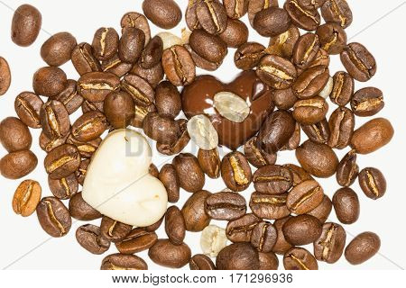 Close Up Of Two Pieces Of Chocolate And Coffee Beans On A White Background