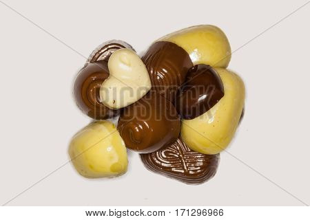 Close Up Of Different Chocolate Pieces On A White Background