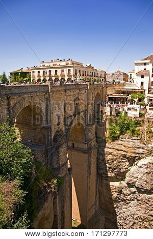 Natural gorge cuts through the town of Ronda, Spain. Tall bridge brings the two halves together.