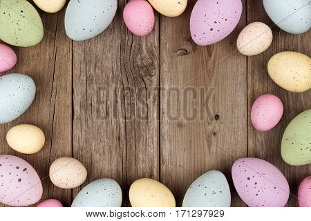 Pastel Speckled Easter Egg Frame Against A Rustic Wood Background