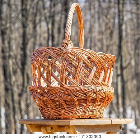 Trade of Handicrafts in the street in the spring. Wicker basket for mushrooms