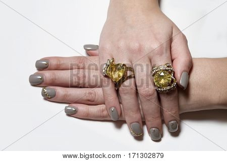 Two Big Yellow Stoned Rings With Nice Manicured Fingernails.