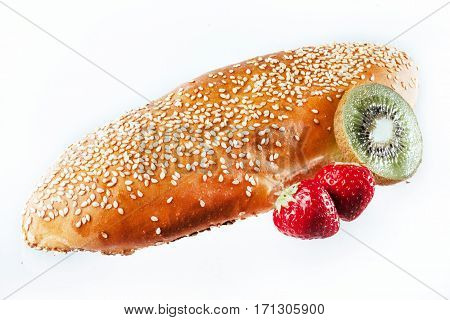 bun sprinkled with sesame seeds on a light background. insulation