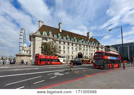 LONDON/ ENGLAND - AUGUST 31. County Hall and Ferris wheel London eye on the south bank of the River Thames on August 31, 2016 in Westminster, London, England.