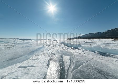 outdoor view of frozen Baikal lake in winter.