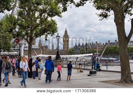 LONDON/ UK - SEPTEMBER 4. The Queen's Walk promenade on the southern bank of the River Thames in London, Uk.