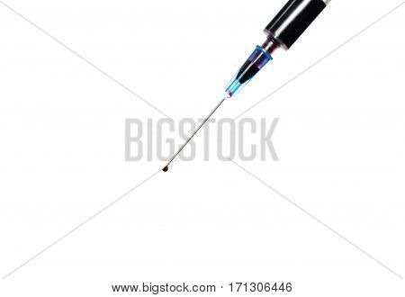 Extracted blood in syringe with hypodermic needle blood drops on isolated white background