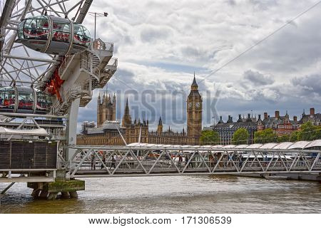 LONDON/ UK - SEPTEMBER 4. View of the central London with tower Big Ben and ferris wheel London Eye on September 4, 2016. UK