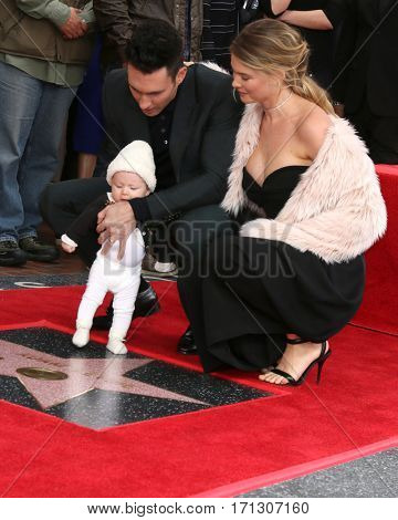 LOS ANGELES - FEB 10:  Adam Levine, Dusty Roee Levine, Behati Prinsloo at the Adam Levine Hollywood Walk of Fame Star Ceremony at Musicians Institute on February 10, 2017 in Los Angeles, CA