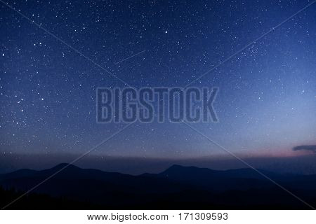 fantastic winter meteor shower and the snow-capped mountains