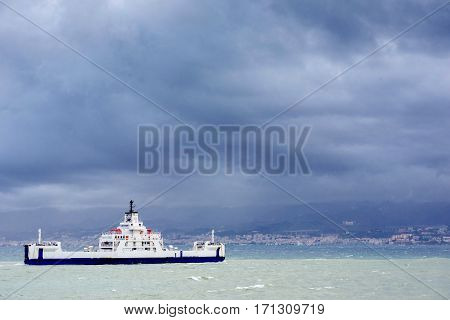 ship at sea under dramatic clouds Sicily. Italy Europe