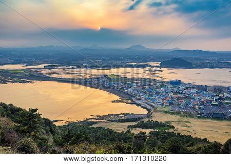 Jeju city skyline when sunset view from Seongsan Ilchulbong Jeju Island South Korea