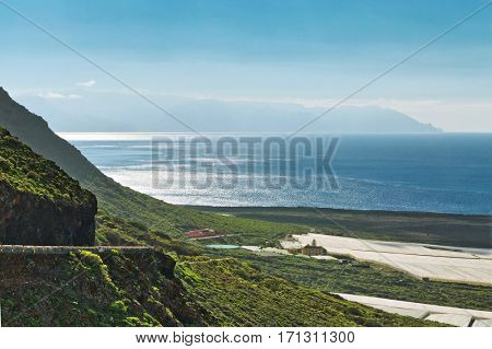 A road and a view by the sea on Tenerife on the Canarian islands.