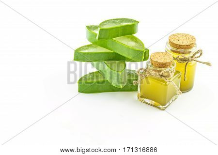 Slice Aloe Vera (Aloe barbadensis Mill.Star cactus Aloin Jafferabad or Barbados) and Aloe vera essential oil isolated on white background.Saved with clipping path.