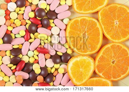 Colorful Medical Pills And Fresh Orange As Background, Health Care And Healthy Lifestyle Concept