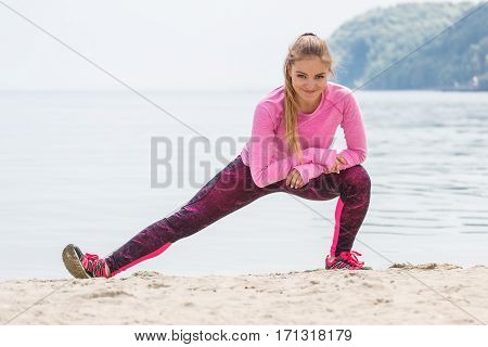 Slim Girl In Sporty Clothes Exercising On Beach At Sea, Healthy Active Lifestyle