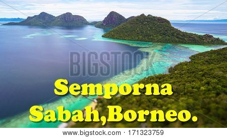 Semporna Sabah Borneo quote concept with Tropical paradise island with bright smooth mirror sand & crystal clear water with rocky shore in the island of Semporna, Borneo, ideal for print card and poster design.