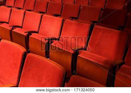 vintage movie theater empty auditorium with red seats
