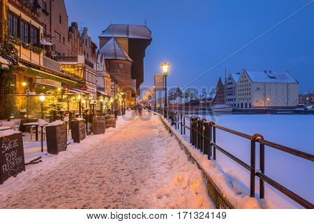 GDANSK, POLAND - FEBRUARY 8, 2017: Old town of Gdansk at Motlawa river in winter, Poland. Gdansk is the historical capital of Polish Pomerania with medieval old town architecture.