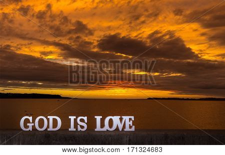 God is Love with a wonderful golden Sunset.