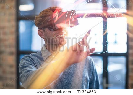 Digital image of planet with big data text against businessman using virtual reality headset in office