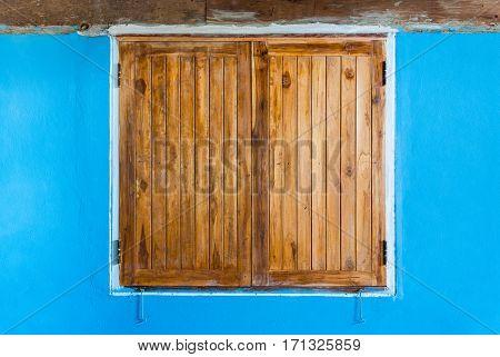 Old Teak Wood Window On Blue Wall
