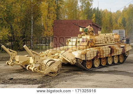 Nizhniy Tagil, Russia - September 25. 2013: BMR-3M. Armoured deminer to demine pathways for column march. It move on the shooting demonstration range. RAE-2013 exhibition