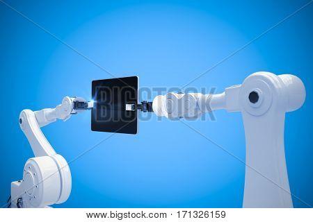 Digital composite image of robots and digital tablet against blue background 3d