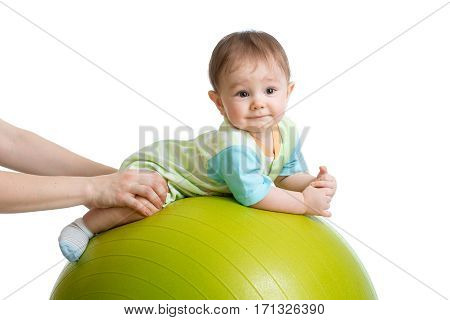 Portrait of smiling baby on fitness ball. Exercise and massage, baby health conception