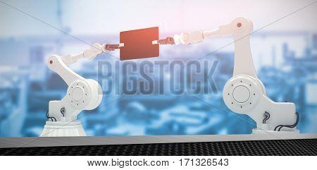 Composite image of robots holding digital tablet against black metal texture 3d