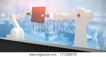 Digital composite image of robots and digital tablet against black metal texture 3d