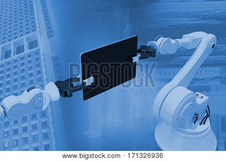 Digital generated image of robots holding computer tablet against view of data technology 3d