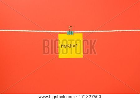 """Yellow Paper Sheet On The String With Text """"monday"""""""