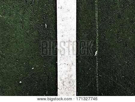 Asphalt, asphalt texture, asphalt background, scabrous asphalt. Road marking. Grunge background. Green asphalt.