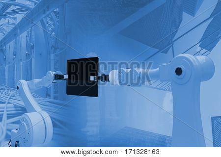 Digital composite image of robots and digital tablet against image of data center 3d