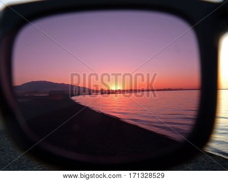 the world through rose-colored glasses  sandy beach