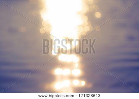 sea, sunbeam on water surface. unfocused background