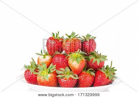 pile of fresh red stawberries in a white plate on isolated white background room for copyspace