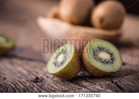 Kiwi Fruit. Several kiwi fruit on oak wooden surface.