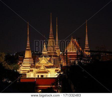 Towers of Wat Phra Kaew in Grand Palace at night, Bangkok, Thailand