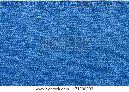 Blue Jeans Cloth With Upper Seam Background Texture Copyspace.