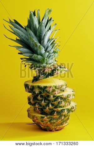 Sliced Pineapple On Yellow Background