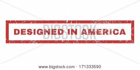 Designed In America text rubber seal stamp watermark. Caption inside rectangular shape with grunge design and scratched texture. Horizontal vector red ink emblem on a white background.