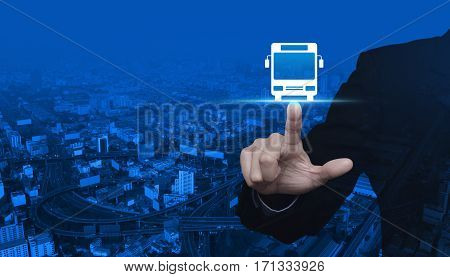 Businessman pressing bus flat icon over modern city tower street and expressway Business transportation service concept