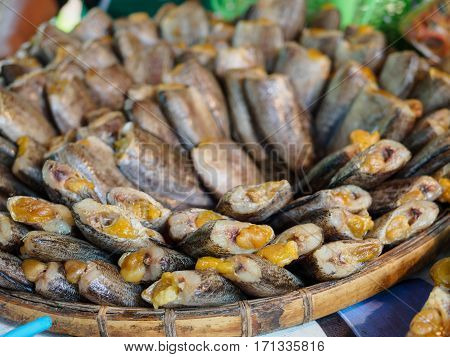 dried salted damsel fish with eggs put on threshing basket