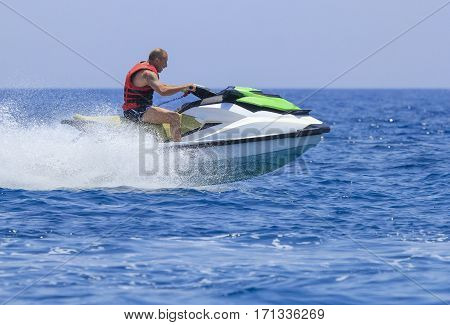 Young man having fun on a jet-ski